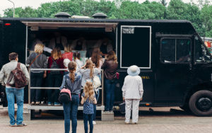 People Getting Food from a Food Truck
